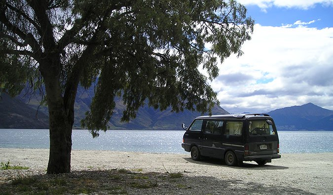 a campervan camping near a lake in New Zealand