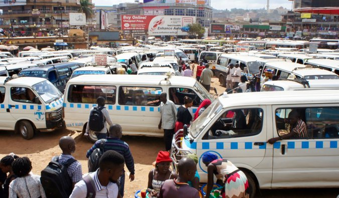 A huge parking lot packed full of minivans and taxis in Africa