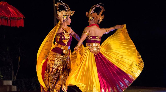 two dancers in bright costumes in Bali