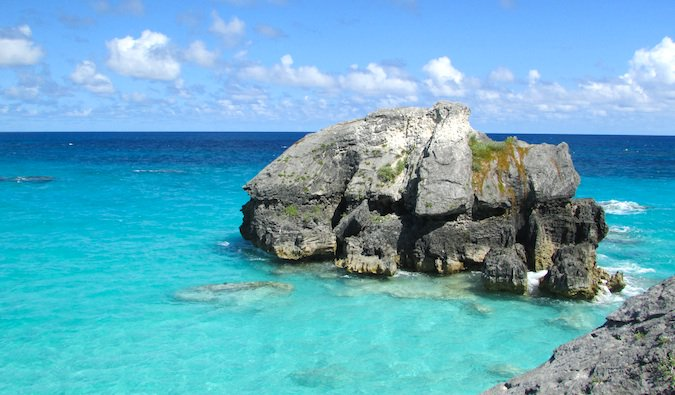 Rock in the clear blue ocean water of the Caribbean