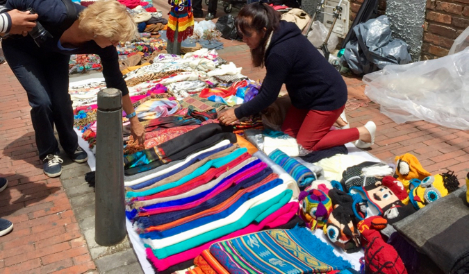 A woman shopping at the Usaquén flea market in Bogota, Colombia