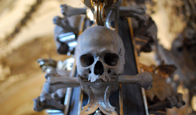 a cracked skull in the sedlec ossuary in prague