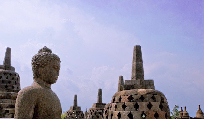 A weathered statue of Buddha at Borobudur in Indonesia