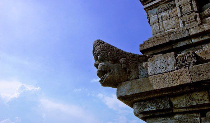 One of the many ancient stone carvings at Borobudur in Indonesia