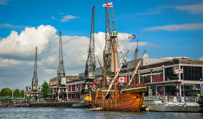 Bristol England%image_alt%27s waterfront with a giant ship