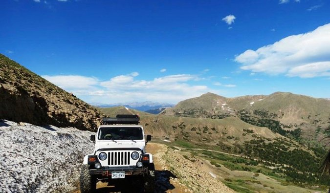A jeep crossing the mountains in Central America
