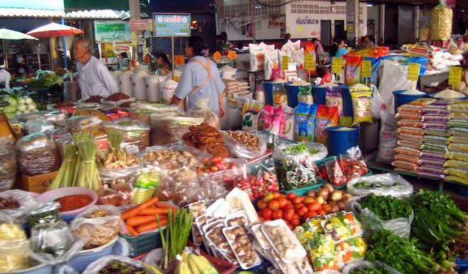 A bustling market full of fruits and vegetables in Asia