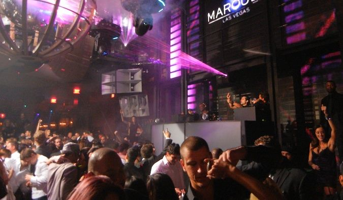 DJ spinning at a hot nightclub in Sin City with fog and purple strobe lights