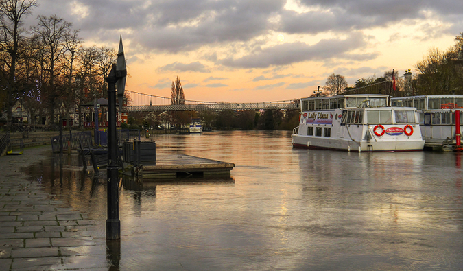 The river cruise boats in Chester England at sunset; Photo by Tim Dutton (flickr: @specky4eyes)