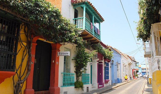 Colorful houses and balconies in Cartagena painted bright colors with lots of greenery