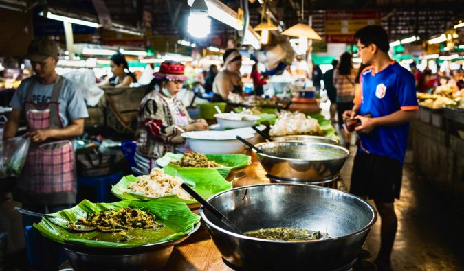 A food market full of people in Asia