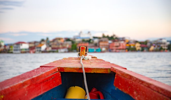 A close-up shot of a small wooden boat ont he water in Central America
