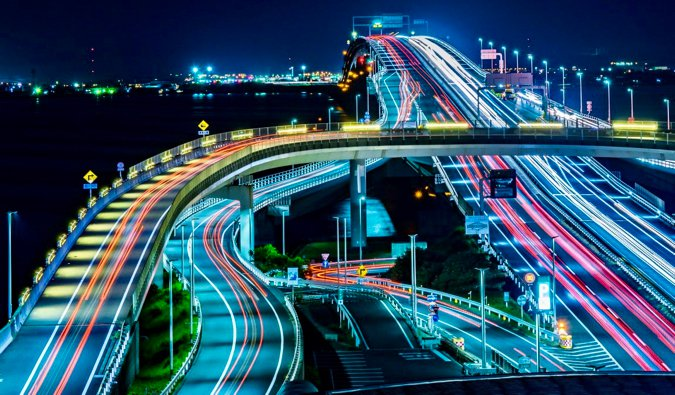 The blurred lights of a busy superhighway in Japan at night