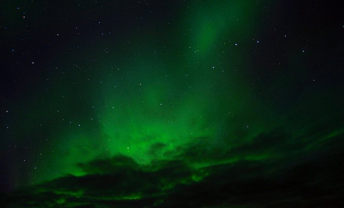 The northern lights lighting the sky up green
