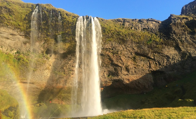 Front side of Seljalandsfoss with a Icelandic rainbow