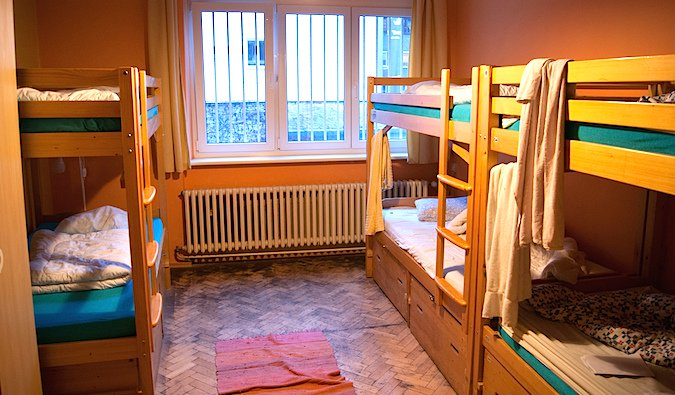 A dorm room full of bunk beds in a hostel