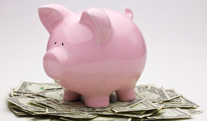 saving money for travel in your piggy bank