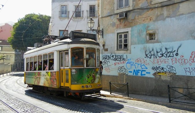 cable car and cobblestone street in Lisbon
