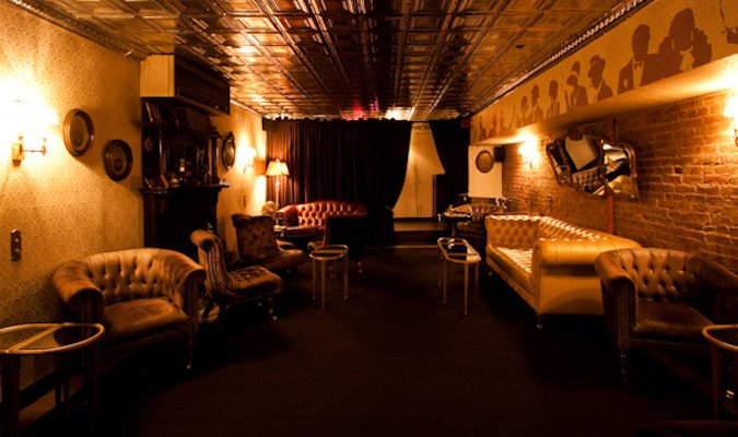 The fancy interior of the Raines Law Room bar in NYC