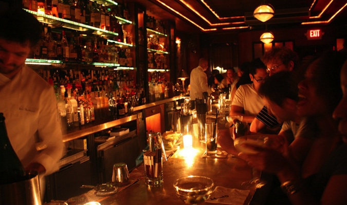 People drinking at the prohibition style speakeasy Little Branch in New York
