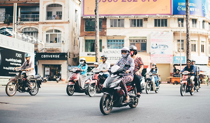 a group of locals riding motorbikes in Vietnam