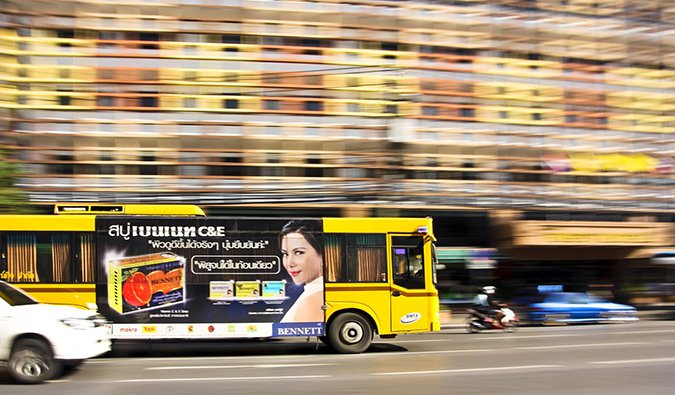 a public bus in motion in Bangkok