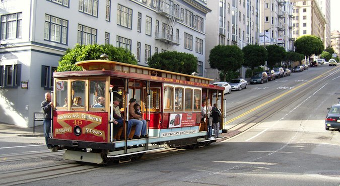 Traditional and iconic cable cars on beautiful street in California