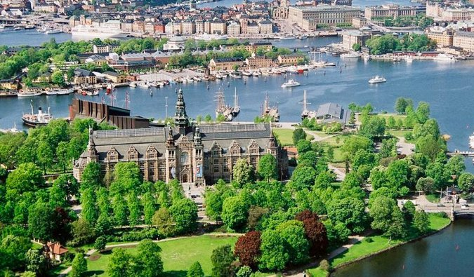 The historic buildings on Djurgården in Stockholm surrounded by green trees and blue water