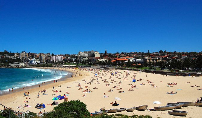 The bustling Coogee Beach on a hot summer day in Sydney, Australia