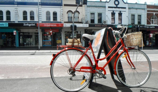 A red bicycle locked up on the street of Sydney$0027s Paddington district