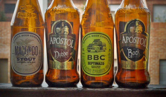 Some of Colombia%image_alt%27s best beers, lined up on a ledge in Medellín, Colombia