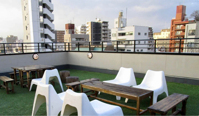 The laid back rooftop common area at Space Hostel in Tokyo, Japan