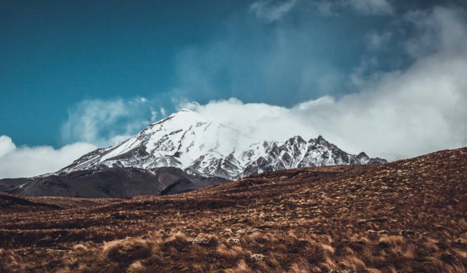 The snow-covered peaks of the Tongariro Alpine Crossing in New Zealand