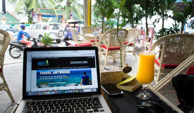 Working remotely from a laptop on a website overseas in tropical Cambodia